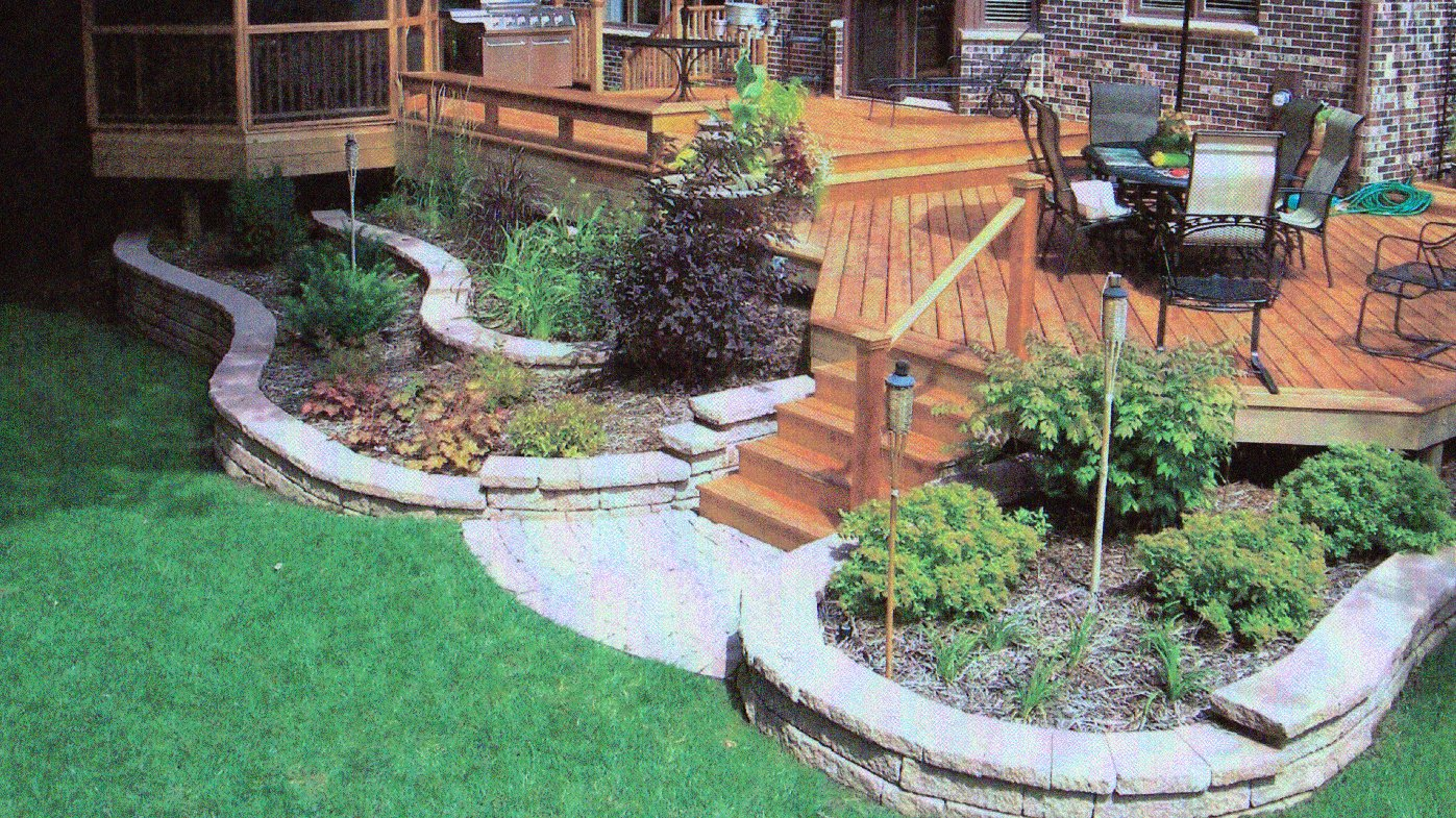 Retaining wall landscaping around deck in rockford il r for Patio landscaping