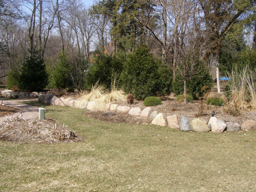 Backyard Boulder Planter Screen with Paver Sidwalk and Patio 2 Image