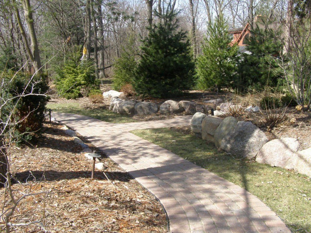 Backyard Boulder Planter Screen with Paver Sidwalk and Patio 4 Image