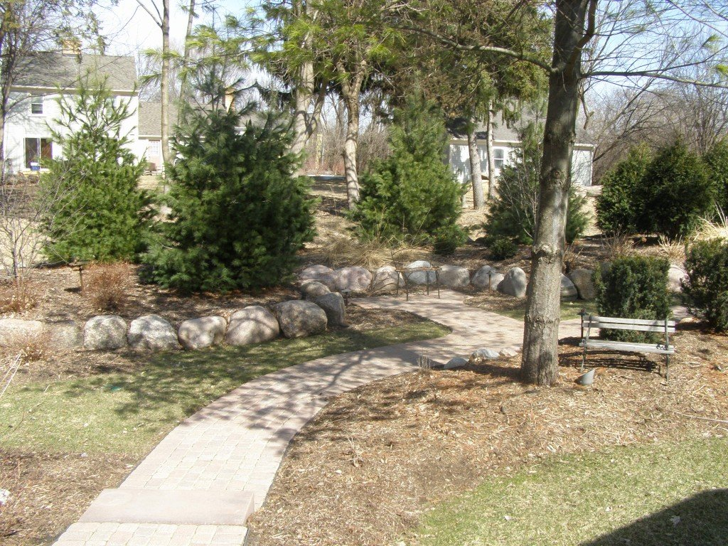 Backyard Boulder Planter Screen with Paver Sidwalk and Patio 7 Image