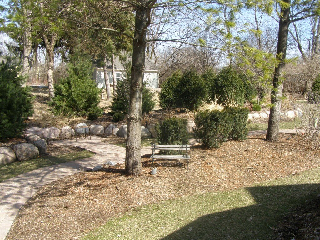 Backyard Boulder Planter Screen with Paver Sidwalk and Patio 8 Image