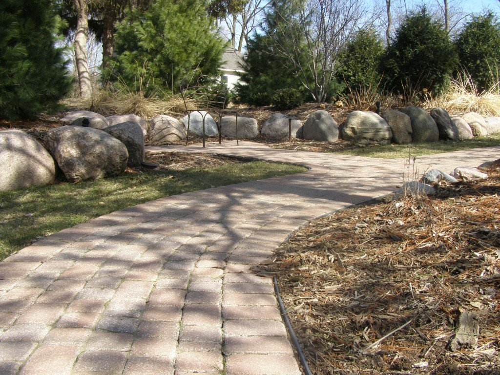 Backyard Boulder Planter Screen with Paver Sidwalk and Patio 13 Image