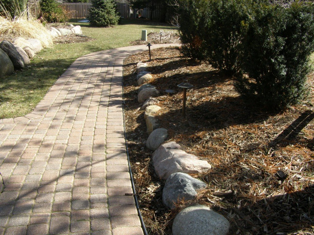 Backyard Boulder Planter Screen with Paver Sidwalk and Patio 15 Image