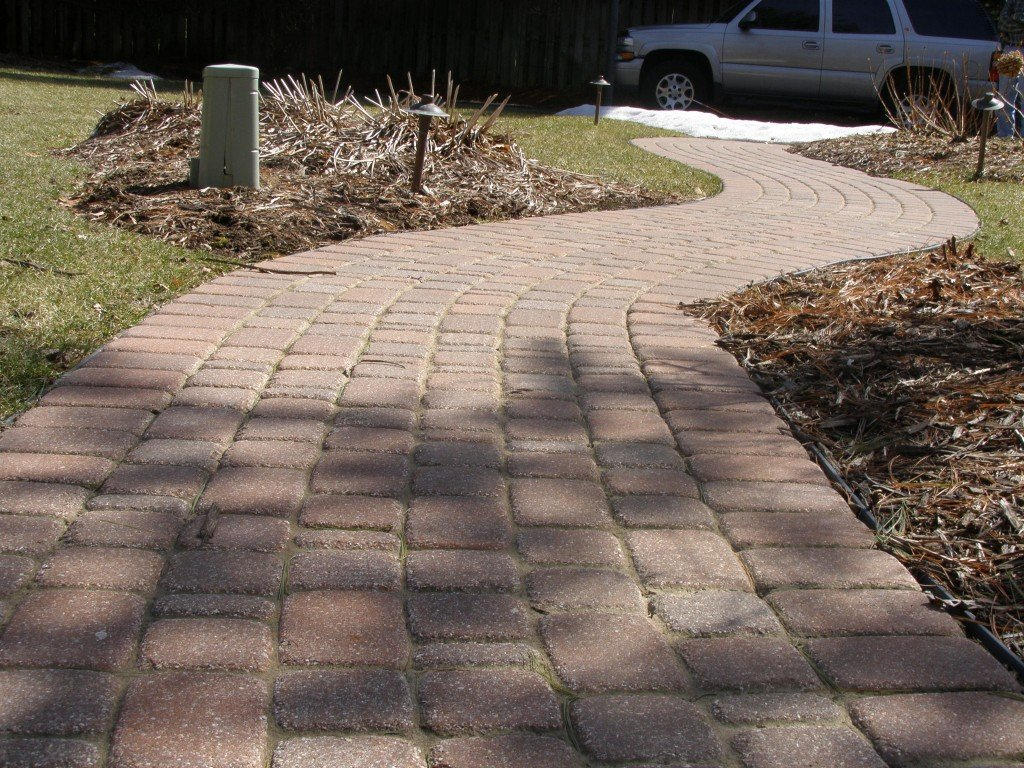 Backyard Boulder Planter Screen with Paver Sidwalk and Patio 19 Image