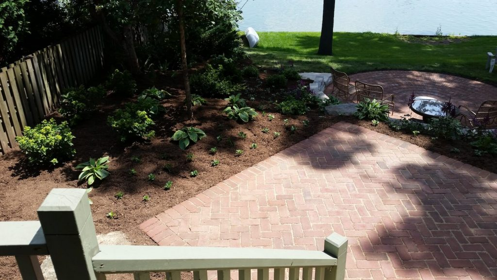 Paver patio with landscape around