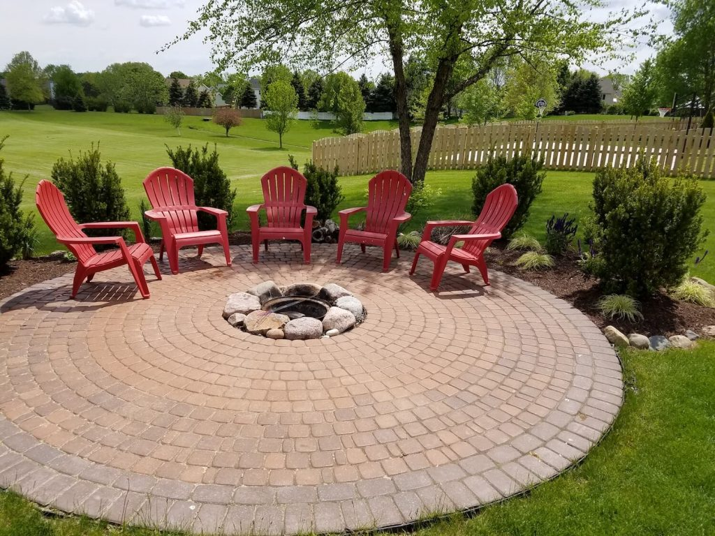 New paver fire pit with new landscaping | RE Marshall | Rockford IL