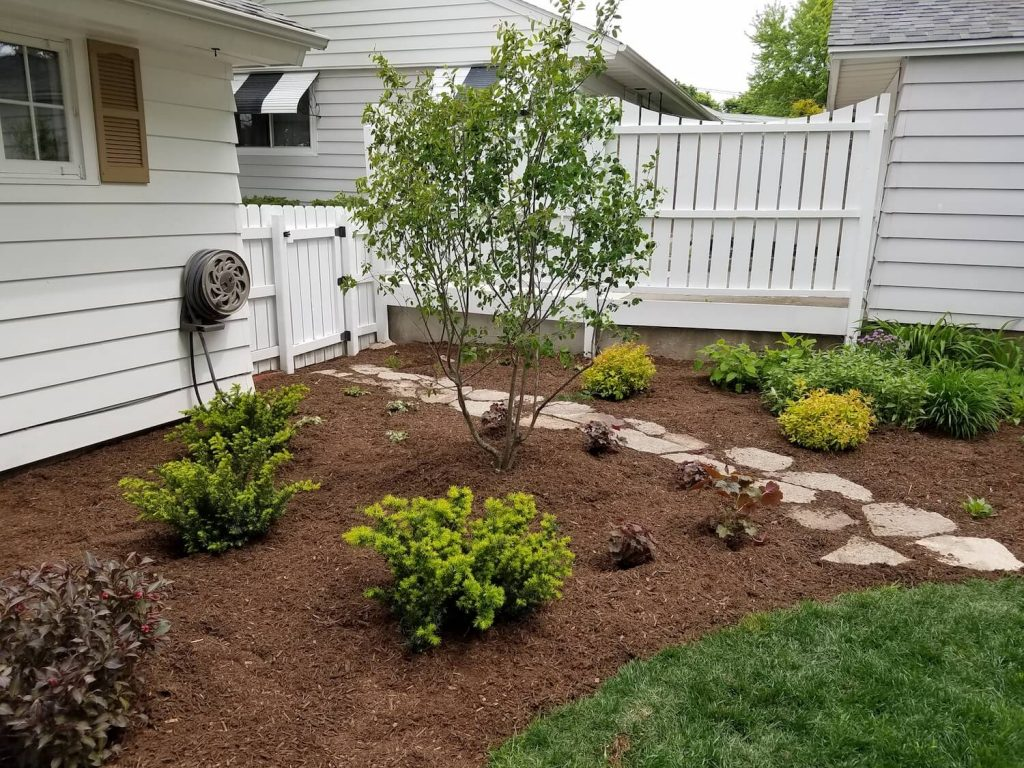 New landscaping with natural stone steppers | RE Marshall | Rockford IL