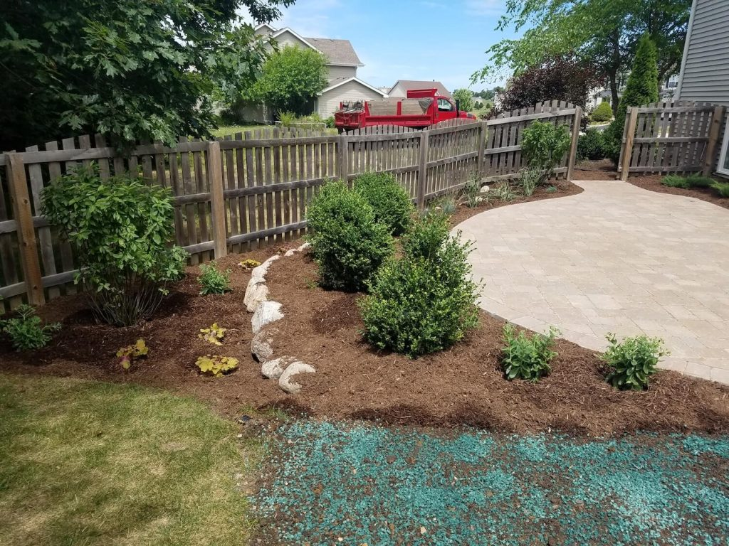 New paver patio and boulder wall and landscape | RE Marshall | Rockford IL