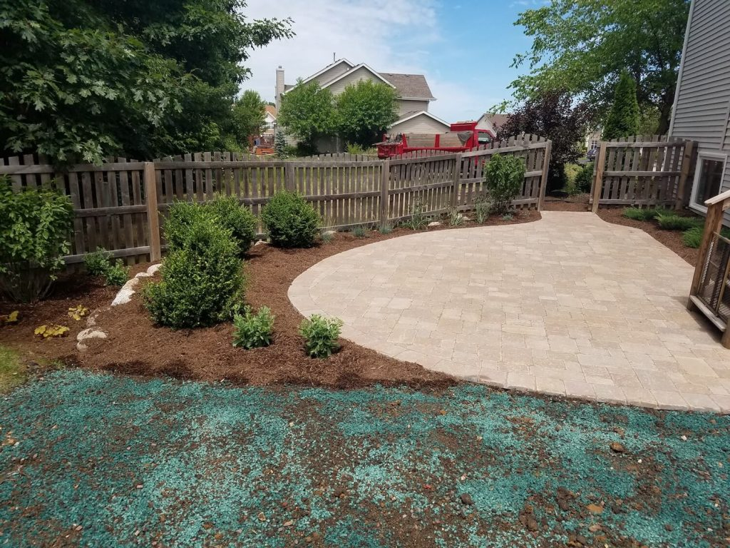 patio and boulder wall | RE Marshall | Rockford IL